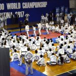 Large group of Taekwon-Do students sitting during a seminar.