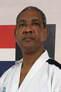 Short haired man in Taekwon-Do uniform.