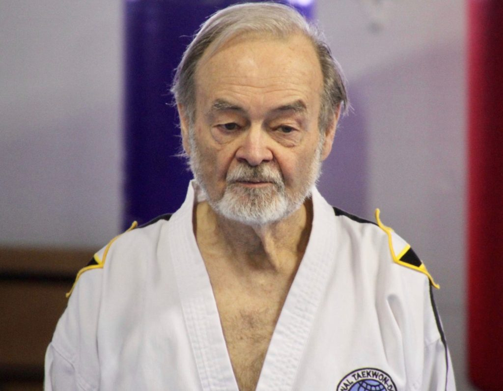 Older man in Taekwon-Do uniform.